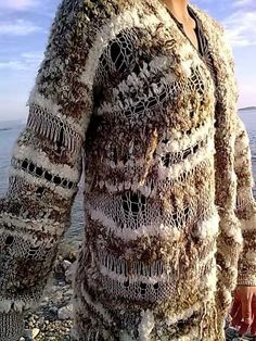 Cardigan made from thick boucle yarn.Losse knitted part is made from viscose yarn.