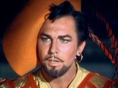 This is Howard Keel.  He starred in Seven Brides for Seven Brothers, Kiss me Kate, was the patriarch on the TV series Dallas, as well as many others.  I <3 him!