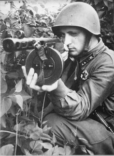 Starshina of the Red Army takes aim with a PPSh-41 submachine gun.