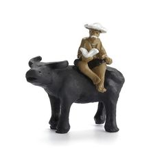 description~ While they are certainly whimsical to behold, this man and ox figure are also inspired by ancient Asian texts and art. He sits atop a friendly and accommodating water buffalo who is lifting its head and giving out a greeting. The man . Miniature Zen Garden, Miniature Gardens, Little Gardens, Water Buffalo, Fairy Garden Accessories, Miniature Figurines, Four Legged, Ox, Whimsical