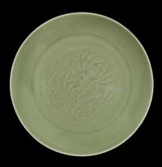 A large Longquan celadon-glazed 'lotus' dish, Early 15th century