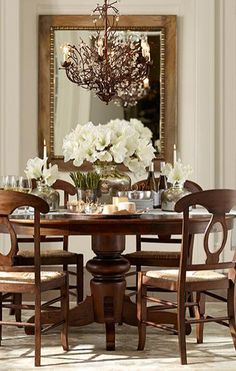 Beautiful dining room table & chandelier http://rstyle.me/n/p59vnn2bn