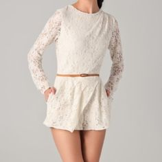 DV by Dolce Vita Lace Romper Pretty cream lace romper from DV by Dolce Vita. Comes with belt. Has pockets and an open slit in the back. Super cute, just never wore it. DV by Dolce Vita Pants Jumpsuits & Rompers