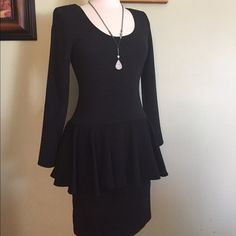 Gorgeous black fitted peplum dress.  Fits best on a size 4. I'm 5'6 and it hits 3 inches above my knees. New without tags. Never worn. Not sure what imported fabric. There are shoulder pads but could easily be cut out of that's your preference. Very pretty. Jody from California Dresses Midi