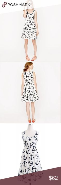 """J. Crew Dizzy Anchors Motif Dress This J. Crew (size 6) crisp cotton dress features shirring at the waistline and a ruffled hem, along with an adorable """"dizzy anchors"""" theme. Other details: navy and white in color, fit and flare silhouette, full lining, a side zip, and trendy side pockets. J. Crew Dresses"""