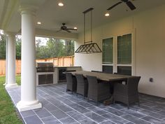 **(Back porch)- Montauk Black Slate Tile, Laticrete Silvershadow Grout, Pottery Barn Greenhouse Light. World Market Chairs< DIY table