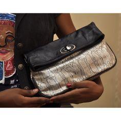 7a0efc810696 Queen Halima foldover clutch.  Handcrafted  Nigeria  Africa  Instagram-   brachahleather