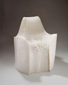 """PAPER CHAIR - TOKUJIN YOSHIOKA - Japan - 2001: Chair made of 120 paper sheets glued together. Layers of paper are partially opened to make a fan-shaped volume, with the vertical spine of the fan at the back. Then the designer seats on the form once it was partially opened, crushing the paper folds and creating the form of the seat and back.  It was later produced in rigid polyethelyne in 2002 for the Italian manufacturer Driade as part of a collection titled """"Tokyo Pop""""."""