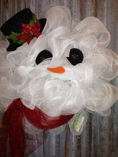Snowman deco mesh wreath. Could do this for a ghost for Halloween as well.