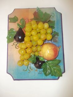 Close-up - wooden plaque, painted and edged, Mediterranean fruit glued, stapled, ModPodged to it.   Makes great wall decor for our Croatian Condo Dining area.