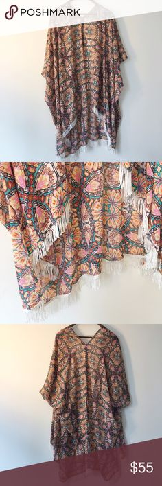 LF Kimono Patterned Kimono with fringe by Millau sold at LF stores. Like-new condition. LF Tops