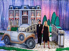 Give your event a 1920's look and feel with our Great Gatsby Kit! This Gatsby Kit features 3 standees and 2 props and lets you personalize the 1920s car. Dob't know if it's too cheesy, but it will certainly fill up the space and we can add to the decor with other elements.