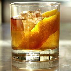 The Mancini       2 ounces Mitcher's rye     1/2 ounce Meletti Amaro     2 dashes smoked cinnamon bitters     2 dashes Orange Bitters     orange twist, to garnish