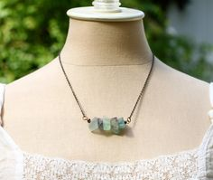this five deep breaths necklace features fluorite stones to aid your intuition.