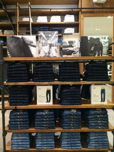 Spring 2013 Merchandising inspiration: AG Jeans, South Coast Plaza   Amazing attention to detail in the folds with POP supported fit guide.  Creates a strong visual presentation with consumer friendly interaction
