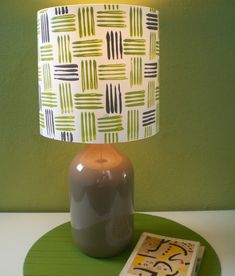 5. Bottle + Fork = Printed Lampshade: First of all, this lampshade was made from scrap using fabric, a glass bottle, and a couple of crafting supplies from around the house, which is awesome. Second, how cool is that pattern? It was made using a fork as a stamp! (via Ohoh Blog)30 DIY Lampshades That Will Light Up Your Life via Brit + Co