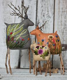 These sweet reindeer feature twigs for antlers and some truly lovely embroidery on their bodies. This is the work of embroidery artist Екатерины Гепты (Catherine Hepta). Fabric Art, Fabric Crafts, Sewing Crafts, Sewing Projects, Sewing Toys, Holiday Crafts, Christmas Crafts, Christmas Ornaments, Christmas Decorations