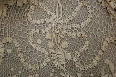1164: An Irish crochet skirt, circa 1910, worked with l : Lot 1164