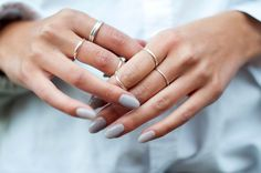 Ice blue nails and delicate silver rings.