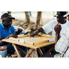 Some Haitians relaxing in the Bateye by playing a competitive game of dominos