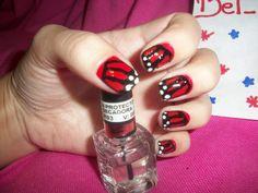manicure rojo con líneas negras
