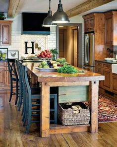 Love the farmhouse table/island