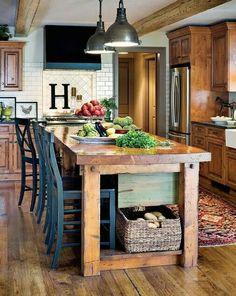 Love the farmhouse table/island
