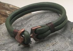 A new take on an anchor bracelet: Men's green leather nautical cuff with copper plated anchor clasp.