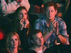 Cressida Bonas wolf whistles while Prince Harry enjoys the show at Wembley Arena.