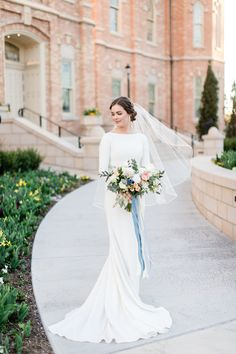 Real bride, Becca, wearing a modest wedding dress - The Markella - at her wedding at Provo City Center Temple. This Meghan Markle inspired modest wedding dress is our favorite simple long sleeve gown! Western Wedding Dresses, Long Wedding Dresses, Long Sleeve Wedding, Bridal Dresses, Wedding Gowns, Lace Wedding, Mermaid Wedding, Modest Wedding Dresses With Sleeves, Dream Wedding