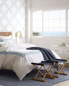 Where to buy wallpaper online. A list of my 12 favorite sources. Serena and Lily blue and white geometric wallpaper in a neutral blue and white bedroom. #geometricwallpaper #bedroomwallpaper