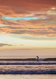 Surfer catching a wave during a pretty sunset in Tamarindo Costa Rica. sunset, sunsets, beach sunset, sunset ocean, sunset photography, sunset pictures, sunset sky, sunset beautiful, sunset surfing, Cielo atardecer, sunset sea, sunset surf, sunset beach surf, sunset beach tropical, sunset Costa Rica, sunset beach waves, sunset beach Summer, sunset beach photography, sunset beach wanderlust,