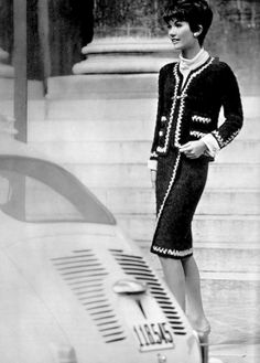 Model in navy blue and white classic suit by Chanel, photo by Georges Saad, 1965