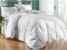 Ritzy down alternative comforter in white. Sizes full, queen or king. Soft, cool and comfy. Machine washable.  #bedding #hypoallergenic #white #comforter