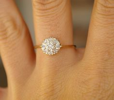 Vintage Diamond Engagement Ring- I like the setting and the mix of the gold with the diamonds in the setting. I like the band also, but I'm not a fan of just one big circle.