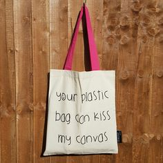 These fun canvas shopper bags are perfect for folding down and popping in your handbag so you're never caught short at the shops!  They're made in London from a high quality and thick canvas material with strong handles so you can load it up.  Mid length twin handles ideal for carrying over your shoulder. Cream fabric with black print text on one side and pink handles.