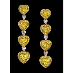 Robert Procop Exceptional Jewels-The earrings are handcrafted in 18K Yellow Gold, each earring holding four Yellow Heart Shape Diamonds for a total carat weight of 5.65cts and three each of Pink Heart Shape Diamonds for a total .45 carat weight.