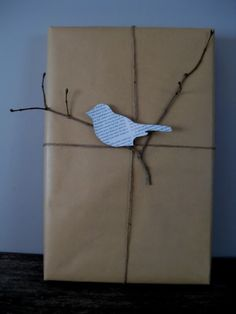 Simple wrapping paper with a a twig from the garden and a paper bird (made from paper, book page, dictionary, newspaper, etc.--very easy, but unique.  Can make a few birds in advance for an easy wrapping.