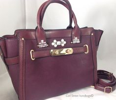 Fall Winter 2016 Collection. Here is a very classic style handbag or brief purse It is a burgundy (cordovan) pebbled faux leather large size handbag tote briefcase. This bag holds a laptop or tablet with ease; still plenty of room for papers, etc. Or carry it as a very classic style handbag on your arm or with the detachable adjustable shoulder strap. Great options. We have embellished this pretty bag subtly, on the front, with Swarovski crystals and faux pearls. Beautiful gold tone…