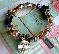 "Great music teacher gift!  ""La papillon et la fleur"" by Gabriel Faure - Amber and midnight blue butterfly wrap bracelet  by HighStrungDiva, $17.00    Available via www.etsy.com/shop/highstrungdiva"