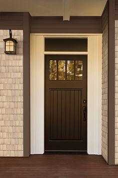 Iron Detailed Lantern, Craftsman Style Door, And Portsmouth Cedar Shingles  In White.