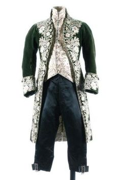 A gentleman's embroidered green velvet court coat and matching ivory satin waistcoat, French, circa 1790. heavily embellished with floss silk flowerheads and foliage; together with a pair of later black satin breeches by rachael