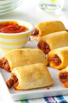 Since receiving this recipe through 4-H, it's been a regular after-school snack. These bite-size pizza treats, made with refrigerated crescent rolls, are especially good served with spaghetti sauce for dipping. —Donna Klettke, Wheatland, Missouri | Pizza Roll-Ups Recipe from Taste of Home