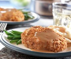 Boneless pork chops are breaded and tossed in the oven to make a crunchy dish for the family. Serve Baked Pork Chops & Gravy with green beans and mashed potatoes and you'll have yourself a meal fit for a king. Pork chop recipes don't get any better o Pork Chop Recipes, Meat Recipes, Cooking Recipes, Recipies, Cooking Games, Kitchen Recipes, Potato Recipes, Dinner Recipes, Pork Chops And Gravy