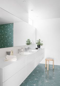 Stylish and playful! This toilet combines white walls with the award-winning Dandelion tiles designed by Claesson Koivisto Rune for Marrakech Design in color Green.