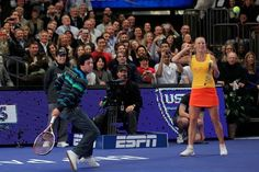 Rory McIlroy relieved his girlfriend at an exhibition match between Caro and Sharapova.  The golf star displayed some touch in hitting a lob winner over Maria's head during their encounter.