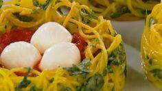 Spaghetti Nests (balls of mozzarella resting in marinara sauce in a nest of spaghetti noodles)