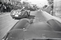 1957 Mille Miglia Peter Collins driving the Ferrari 335 Sport photo by Louis Klemantaski