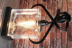 Re-purposed Vintage Black Metal Ice Clamp with a Glass Block Upcycled into an Industrial Table Lamp with a Edison Light Bulb by Loftyideas4u by Loftyideas4u on Etsy.  #Glassblock #Industrial #Repurposed #Iceclamp #tablelamp #upcycled #loftyideas4u