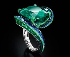 """High Jewellery Collection Ring by De Grisogono, Emeralds and Sapphires set in White Gold. """" High jewellery is the purest expression of de Grisogono style. A spectacular theatre of Contemporary Baroque. The art of an unorthodox Jewellery approach. Emerald Jewelry, High Jewelry, I Love Jewelry, Luxury Jewelry, Jewelry Rings, Jewelry Accessories, Jewelry Design, Emerald Rings, Ruby Rings"""